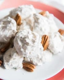 old fashioned divinity and pecans on a red and white plate