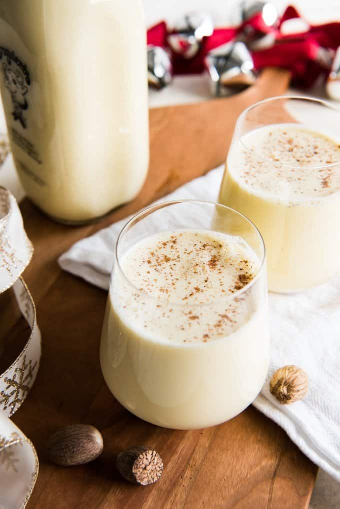 two glasses of homemade eggnog with grated nutmeg on top