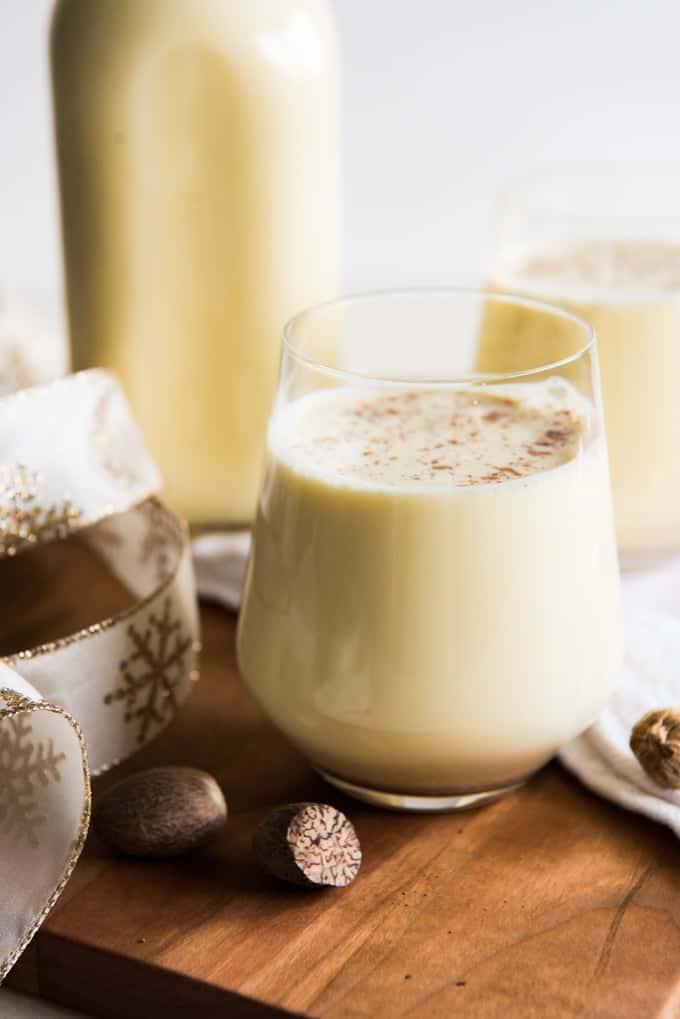 Light, creamy, and spiced with freshly grated nutmeg, this non-alcoholic Old Fashioned Homemade Eggnog is so, SO much better than the store-bought variety that shows up in cartons each year around November or December.  It is both a beloved and beleaguered holiday beverage with a fascinating history.