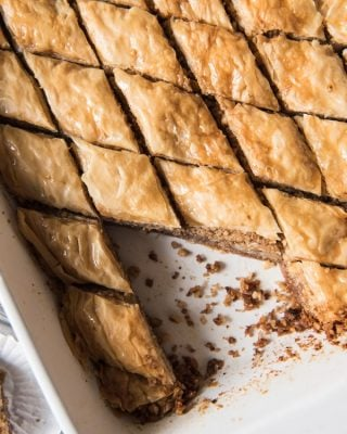 This Greek Baklava recipe has walnuts and cinnamon layered between flaky phyllo dough brushed with melted butter then baked and drizzled with a sugar and honey syrup to create a crispy, sweet, and impressive dessert!