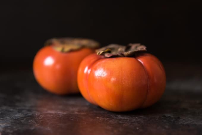 Ripe, seasonal Fuyu persimmons are a perfect addition to a spinach salad.