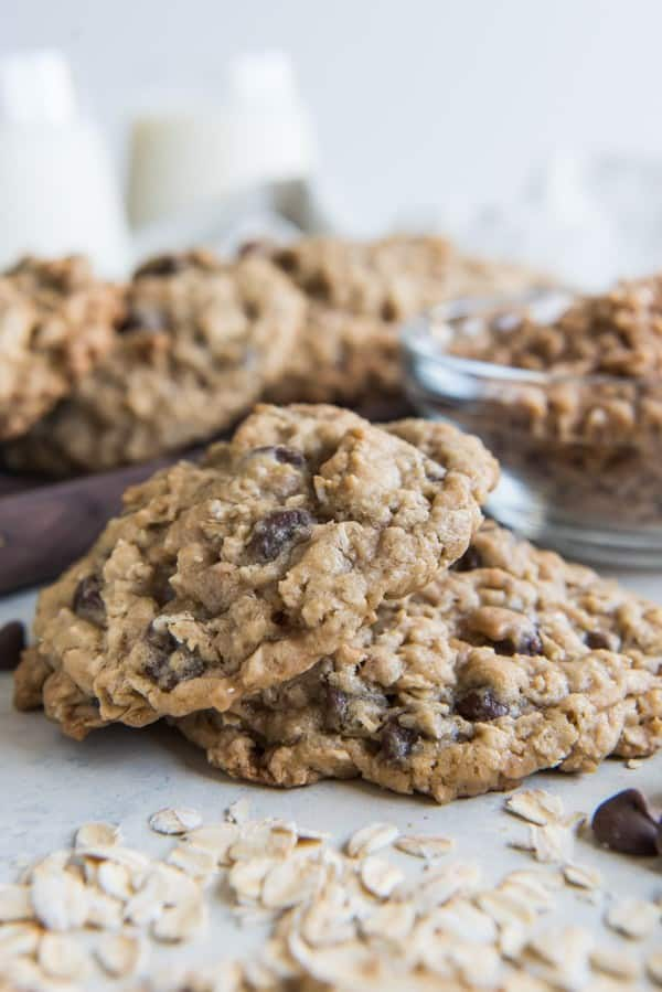 baked toffee oatmeal chocolate chip cookies with oats scattered in front