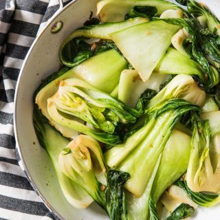 Stir-Fried Baby Bok Choy is a simple vegetable side dish that is ready in under 10 minutes start to finish.  It's a little garlicky with a great tender-crisp texture and one of my go-to veggie options when I'm making a more protein-centric main dish and want a great vegetable to serve.