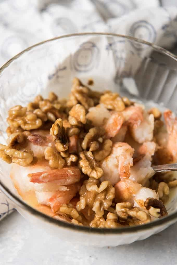 Crispy shrimp and walnuts in a bowl.