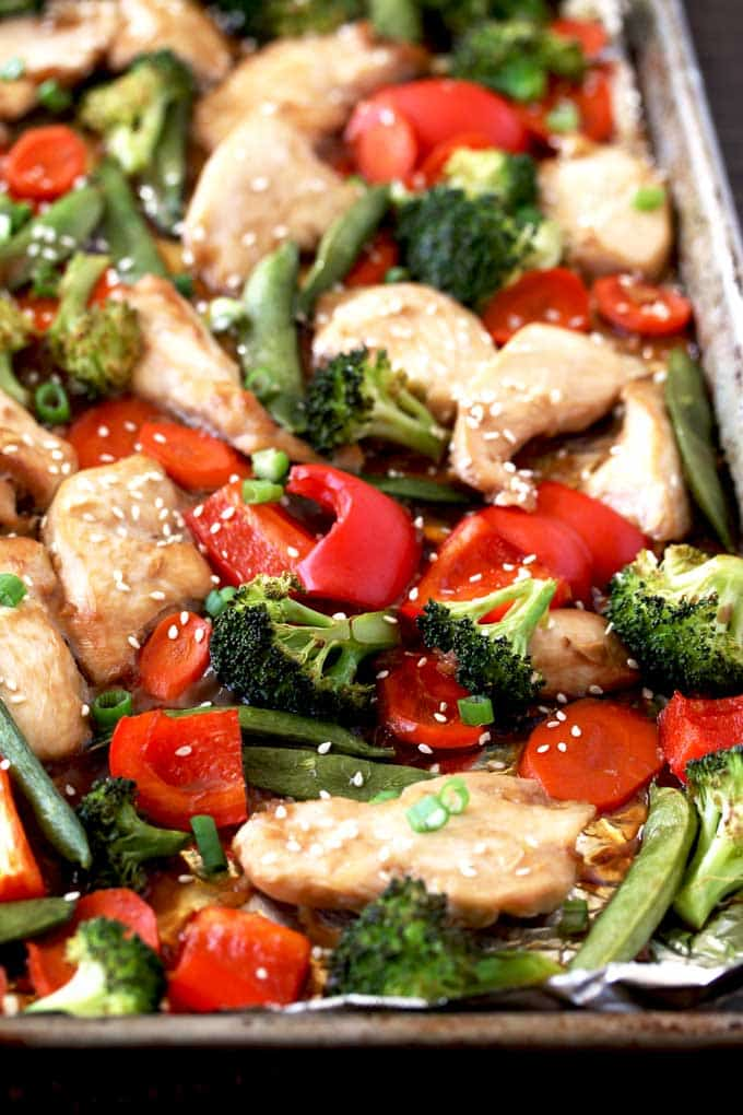 Sheet Pan Chicken and Vegetables Stir-Fry with red bell peppers, broccoli, and chicken in a simple stir-fry sauce.