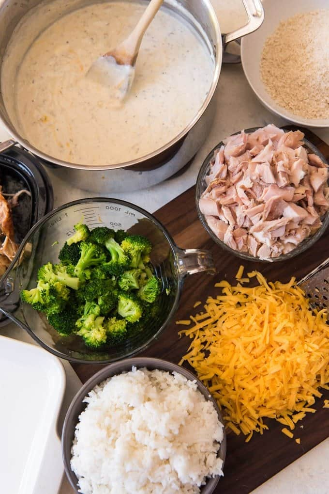 All the ingredients for a chicken broccoli and rice casserole in separate bowls and ready to be assembled.