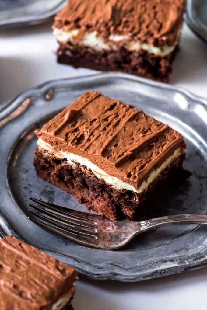 These Fudgy Frosted Chocolate Mint Brownies have a double layer of mint and chocolate frosting on top of a dense, fudgy brownie.  If you are a fan of mint chocolate desserts, these are the brownies for you!  Perfect for a St. Patrick's Day dessert or for any day of the year.