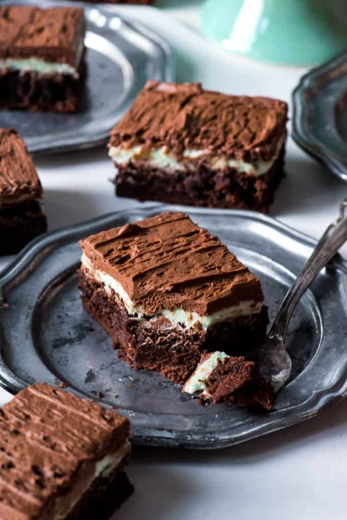 These Fudgy Frosted Mint Chocolate Brownies have a double layer of mint and chocolate frosting on top of a dense, fudgy brownie.  If you are a fan of mint chocolate desserts, these are the brownies for you!  Perfect for a St. Patrick's Day dessert or for any day of the year.
