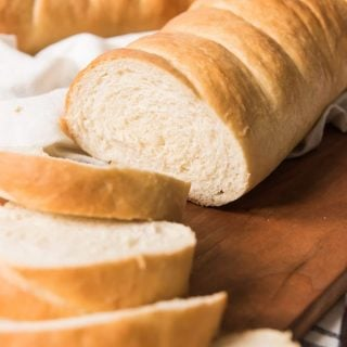 Learn how to make french bread at home with this best ever, easy Homemade French Bread recipe!