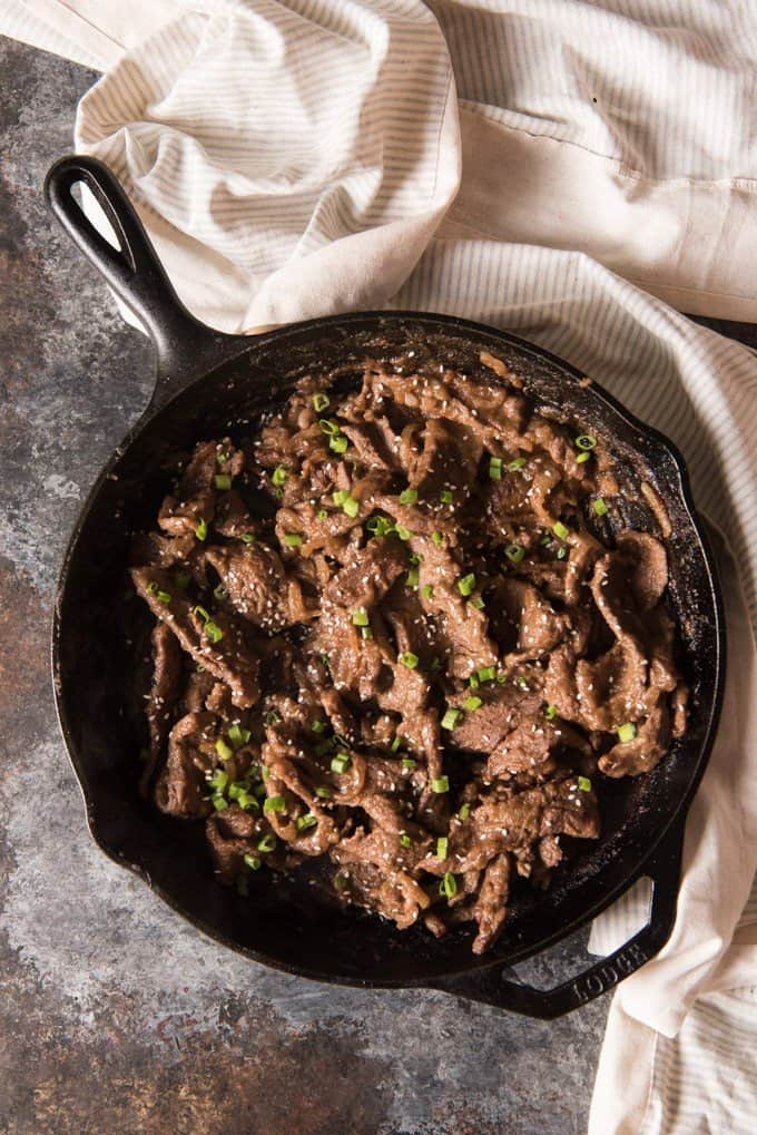 A large skillet full of Korean bulgogi beef.