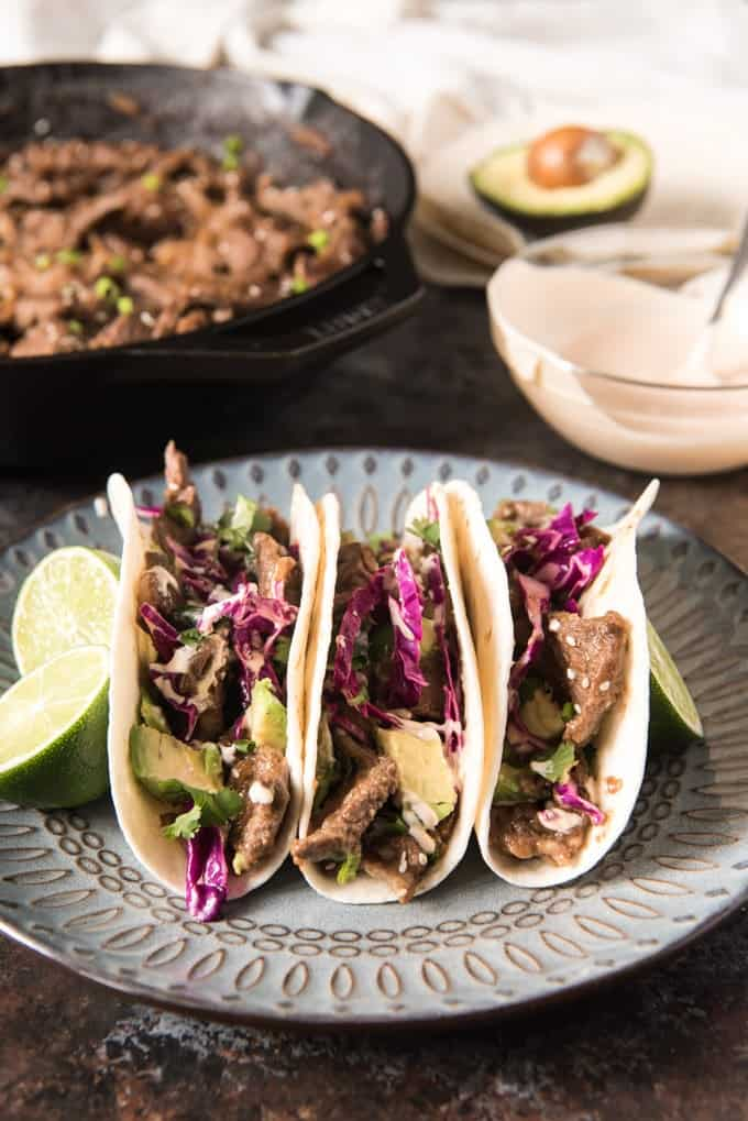 Korean Beef Tacos made with tender bulgogi beef is a fantastic mash-up of Korean, American, and Mexican cuisine all in one delicious, flavor-packed fusion dish that is sure to change up your Taco Tuesday tradition!