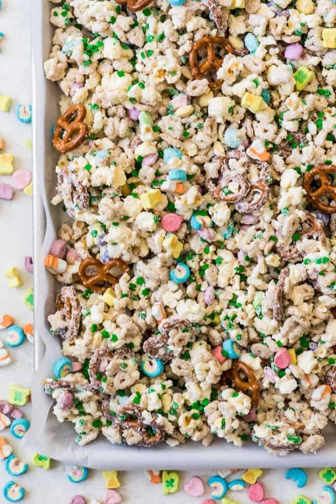 An image of leprechaun bait cereal mix made with Lucky Charms cereal, popcorn, pretzels, M&M's and white chocolate.