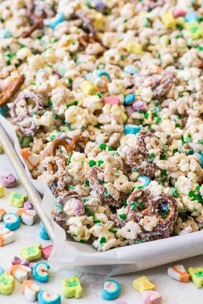 a baking sheet full of lucky charm snack mix