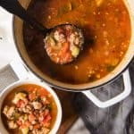 This easy minestrone soup recipe has a rich, flavorful tomato-y broth that is loaded with vegetables, Italian sausage, and beans.  It's hearty, healthy (so many veggies!), and comforting, and this traditional minestrone soup can be made on the stovetop or in the crockpot.