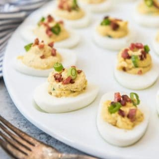 Classic deviled eggs get a savory update with chopped crispy bacon and fresh green onion in these Bacon Green Onion Deviled Eggs.  Perfect for using up your leftover hard-boiled Easter eggs or taking to summer BBQ's and cookouts!