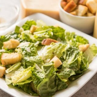 Homemade Caesar Salad Dressing makes a huge impact in this Classic Caesar Salad made with crisp romaine lettuce, crunchy croutons, nutty Parmesan, and of course, the original savory dressing that is so much better than the bottled kind you get at the store!