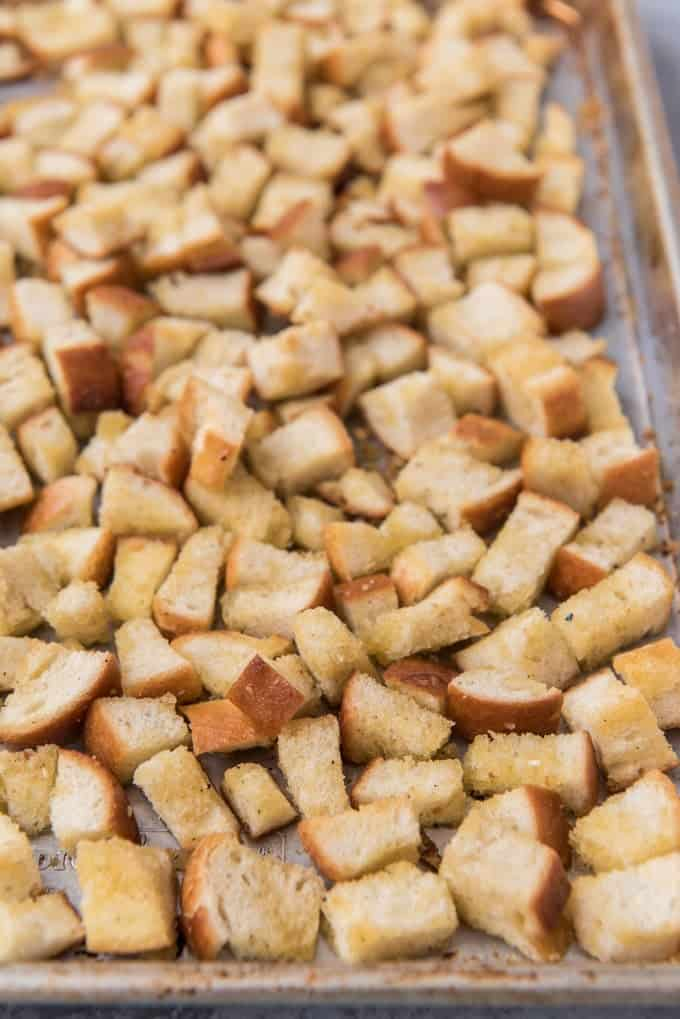 An image of homemade croutons on a baking sheet.