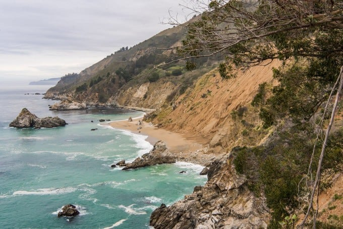 Big Sur is a rugged stretch of majestic California coastline offering beaches, hiking, camping, scenic bridges, a lighthouse, breathtaking waterfalls and sheer cliff faces.  Whether you are planning a day trip to Big Sur or a longer stay, don't miss these stops in Big Sur!