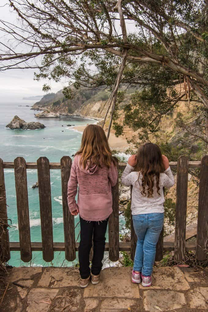 An image of two children overlooking the rugged California coastline from Julia Pfeiffer Burns State Park.