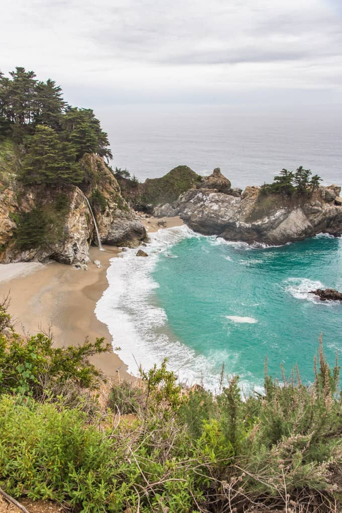 Wondering what to do in Big Sur? Be sure not to miss McWay Falls where a waterfall pours right onto the beach!