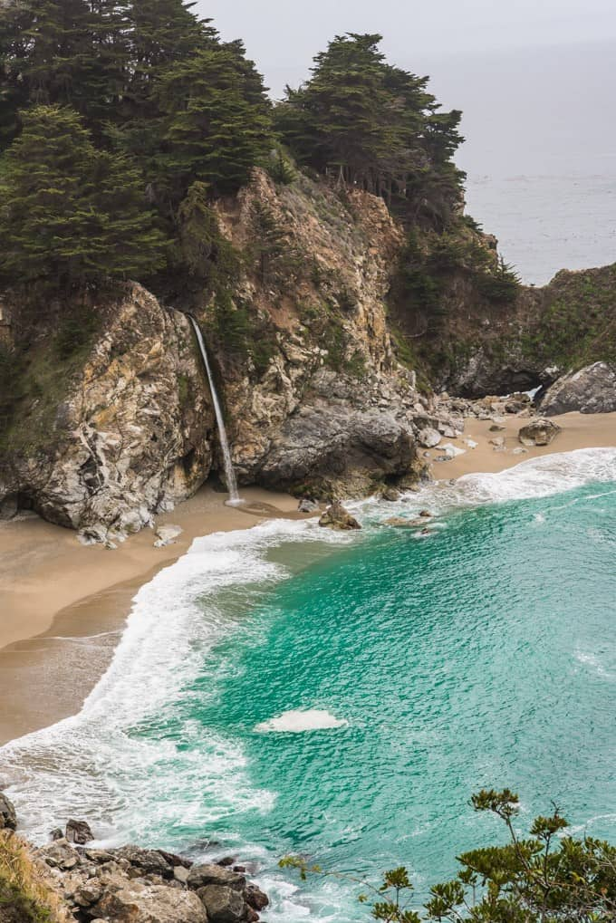 McWay Falls is a stunningly beautiful waterfall (also called a tidefall) that empties right into the ocean with a little sandy beach and cove with turqouise water.