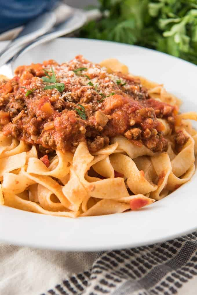 An image of tagliatelle bolognese one a large white plate.