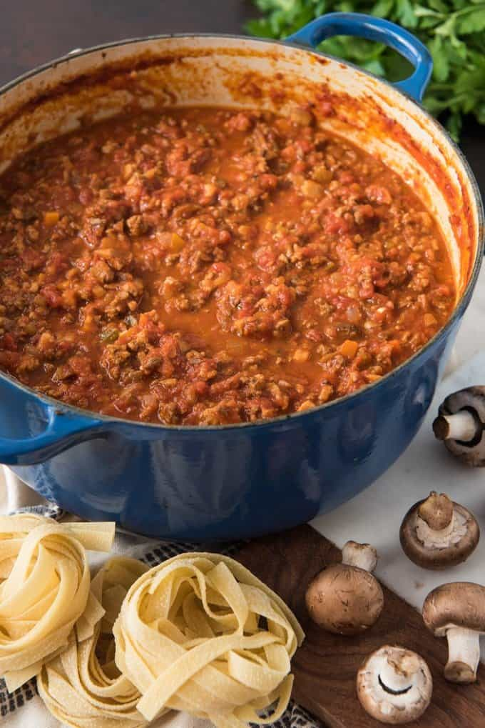 A large dutch oven of the best bolognese sauce recipe ever made with beef, pork, pancetta, and mushrooms.