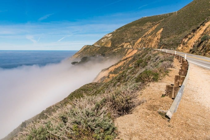 An image of fog along a winding turn along the PCH driving from Carmel south through Big Sur.