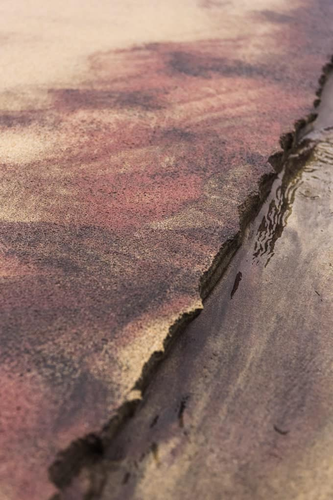 An image of the purple sand at Pfeiffer Beach in Big Sur, California.