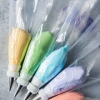 frosting piping bags with fitted tips and each conatining a different color of royal icing
