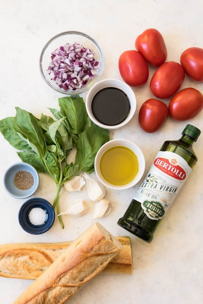 An image of the ingredients for classic bruschetta with a balsamic vinegar reduction.