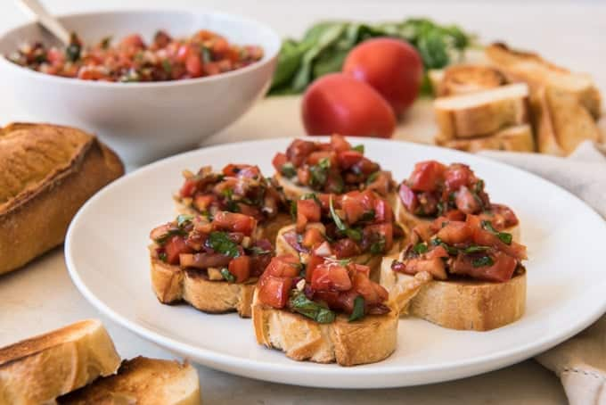 An image of a serving plate with individual bruschetta toasts for serving to guests as an appetizer.