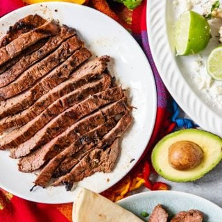 This authentic carne asada recipe makes the most delicious grilled beef that is perfect for eating on its own or adding to tacos, salads, or burritos!