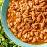 Forget tacos and celebrate Cinco de Mayo with some Charro Beans (Frijoles Charros) cooked in the Instant Pot and served alongside some carne asada, grilled Mexican street corn, fresh tortillas, and horchata for a delicious and culturally authentic Mexican food experience at home!