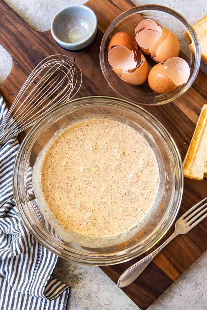 An image of a cinnamon-vanilla egg custard for dipping stale bread to make the best french toast sticks.