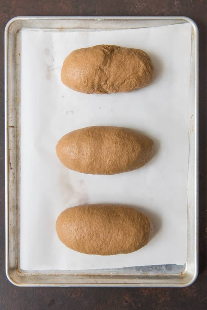 Three loaves of sweet brown bread, just like Outback Steakhouse serves, ready to rise before going into the oven.