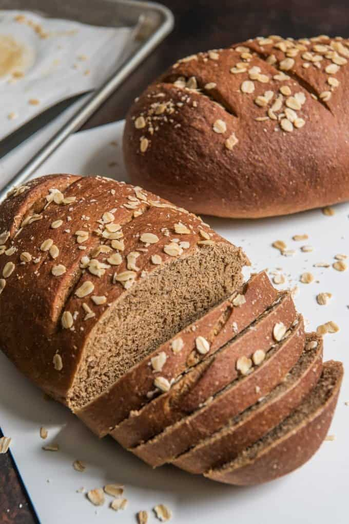 A sliced loaf of homemade brown bread, slightly sweetened and perfect for sandwiches.