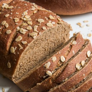Delicious sliced warm and served with fresh butter, or used as sandwich bread the next day, this sweet molasses brown bread made with whole wheat, molasses and honey is one of our family favorites!