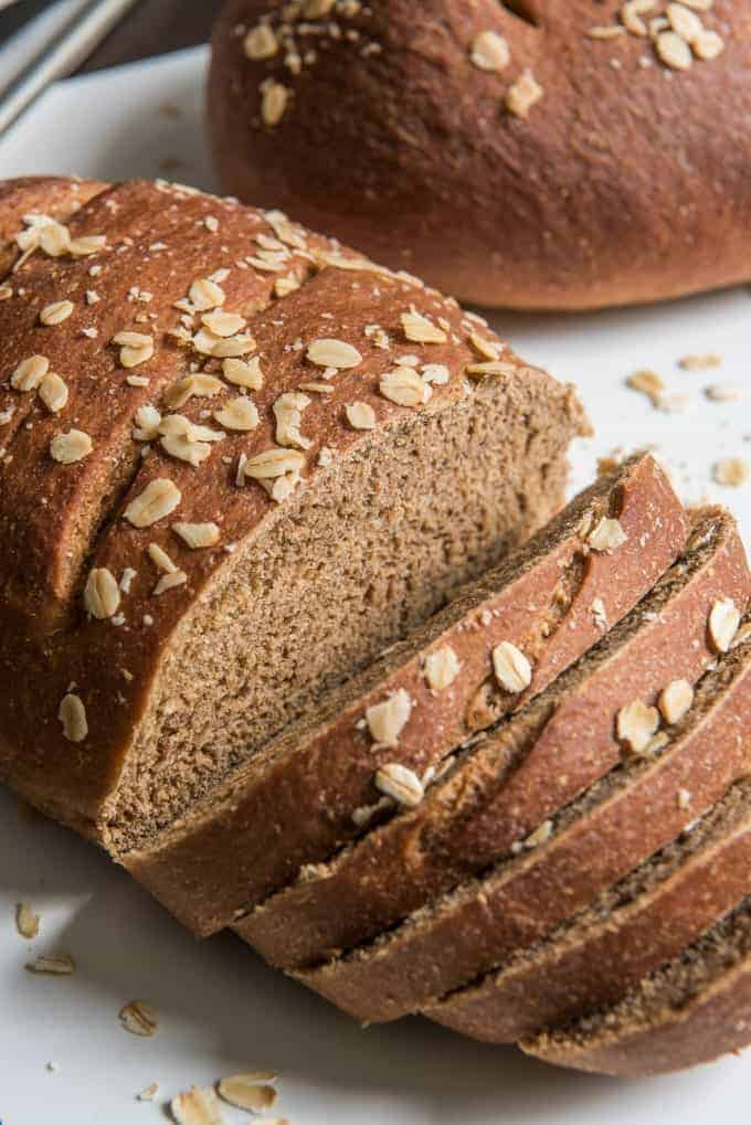 sliced brown molasses bread with oats on top