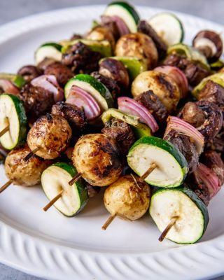 Marinated Steak Kabobs are the perfect summer meal idea for grilling season, and extra delicious when the meat is marinated for hours in the best beef kabob marinade, then skewered with potatoes, onions, peppers, and other colorful veggies!  This fantastic shish kabob marinade helps makes this an easy summer meal the whole family will love!