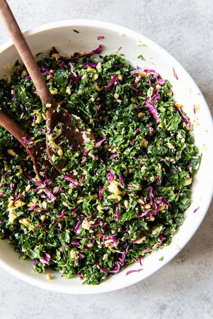 An image of a bowl of chopped kale salad tossed with a light lemon vinaigrette.