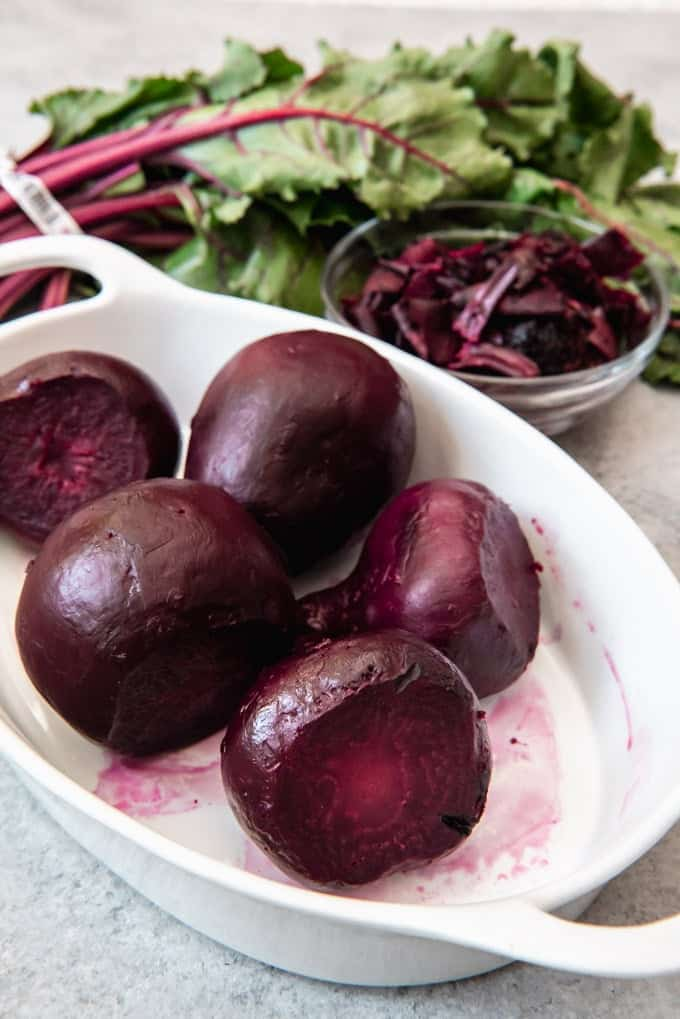 An image of roasted beets with the skins peeled off.