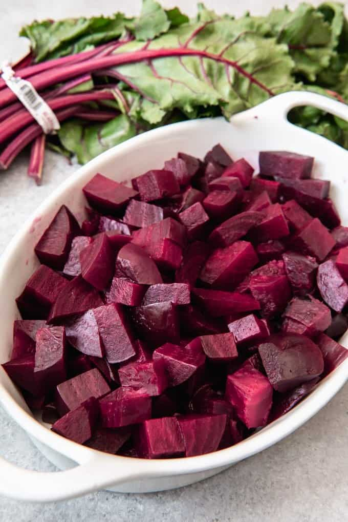 An image of roasted beets that have been diced into bite-size pieces.