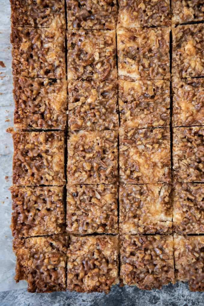 Cheesecake squares made with pecan pie filling on top and cut into 24 pieces.