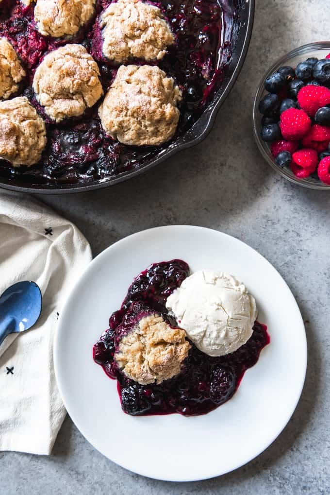 Berry cobbler is an unpretentious, homey dessert and is made even more rustic when presented in a cast iron skillet!  Alaskan Mixed Berry Cobbler with Buttermilk Biscuits is an homage to the plentiful wild berries that abound in Alaska each summer!