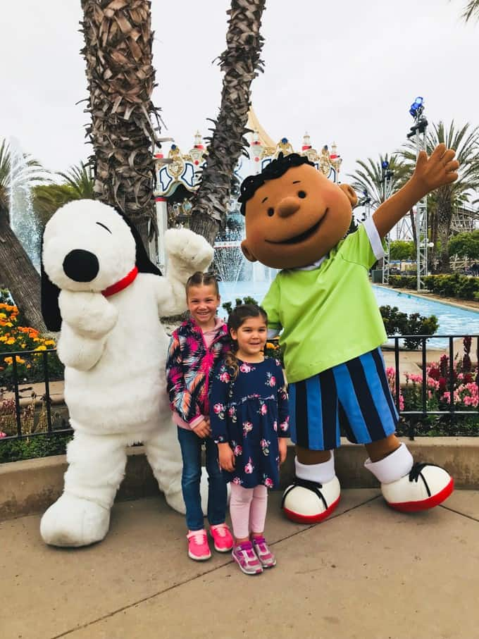 An image of two children with characters at California's Great America amusement park.
