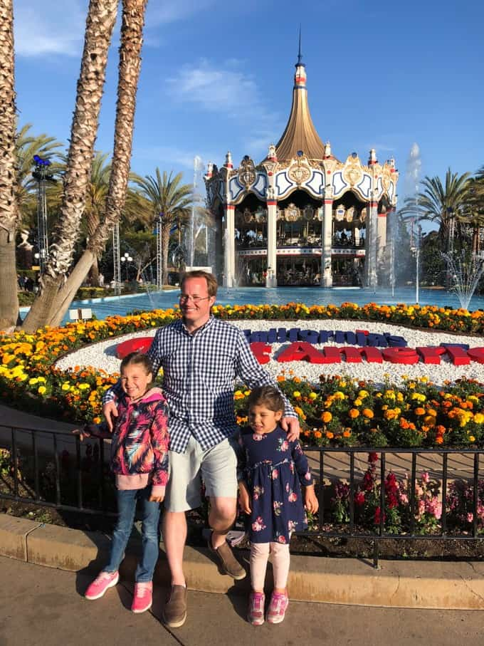 An image of a dad and his two daughters at California's Great America.