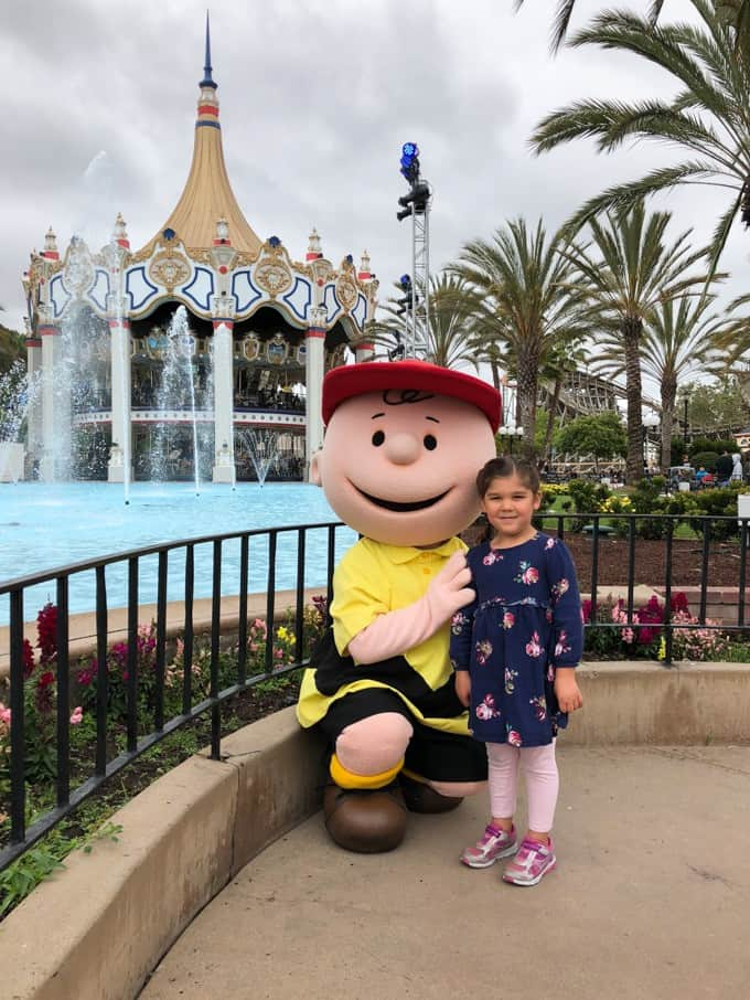 An image of a child with Charlie Brown at California's Great America amusement park.
