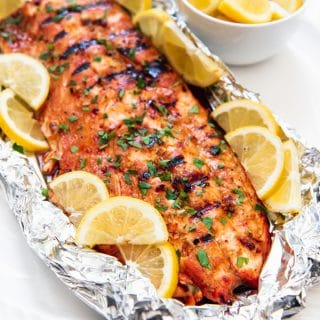 Grilling this Soy Brown Sugar Salmon in Foil makes for an easy weeknight dinner that is impressive enough to serve as weekend fare for guests. The salmon is first marinated in a simple marinade, the sealed in foil and grilled (or baked!) for about 15 minutes just until it flakes apart!