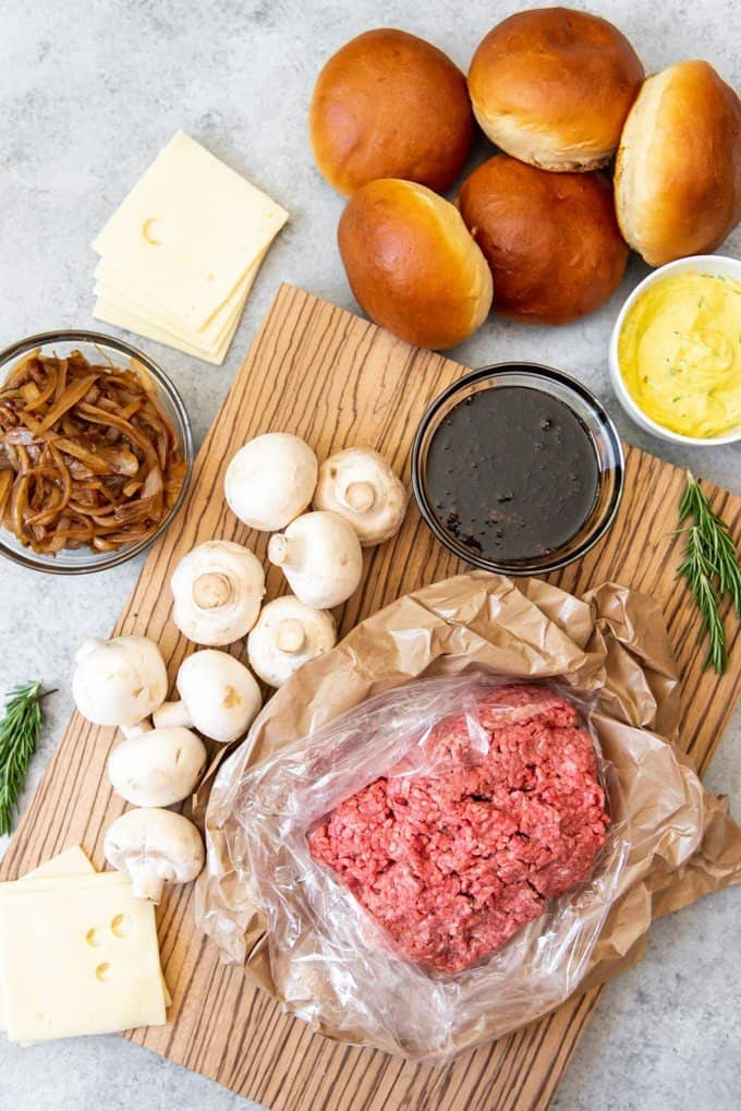 An image of the ingredients for making soy-glazed swiss mushroom burgers with caramelized onions, rosemary aioli and challah hamburger buns.